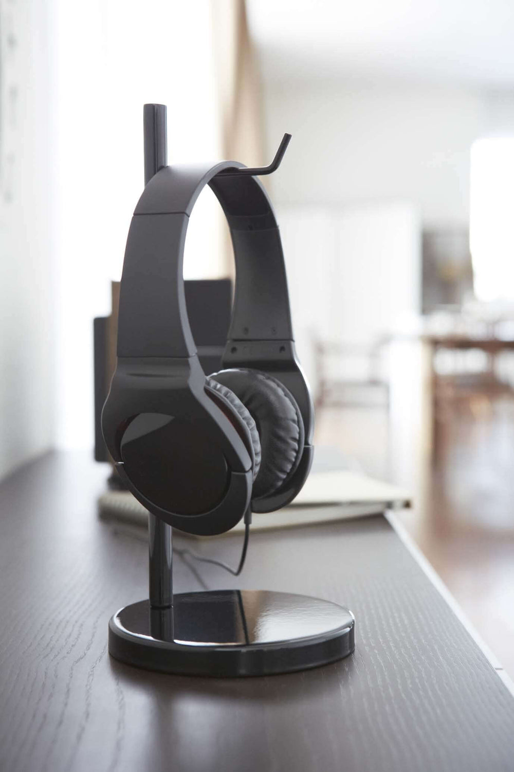 Close look at Yamazaki headphone stand holding headphones.