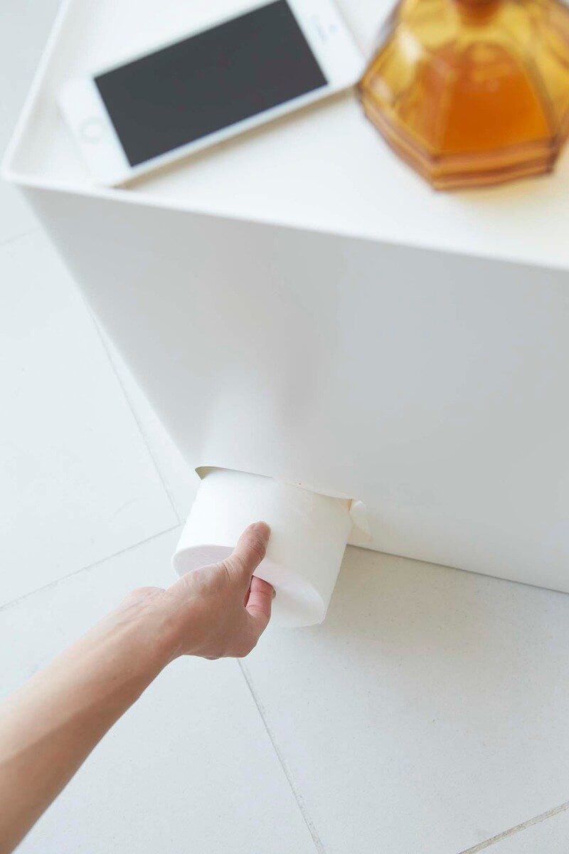 Removing a roll of toilet paper from the Yamazaki stash box.