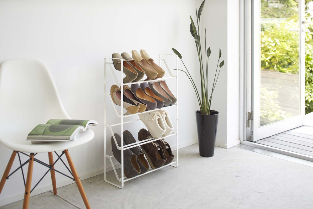White Yamazaki shoe rack with angled shelves