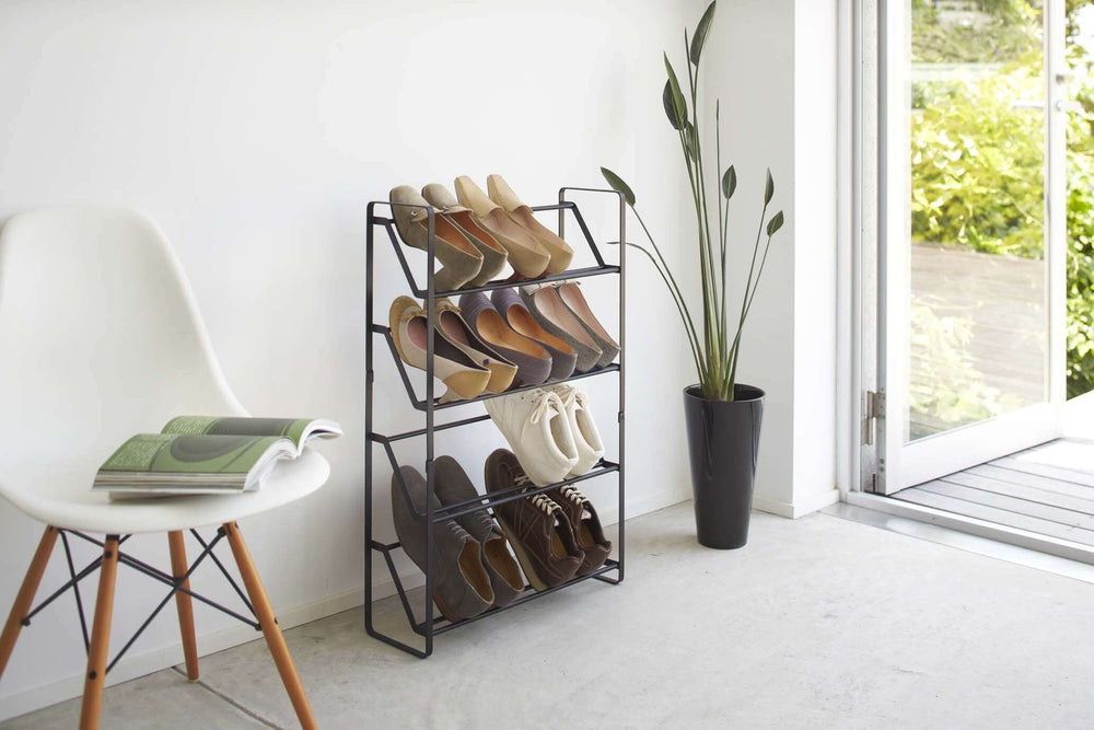 Black Yamazaki shoe rack with angled shelves