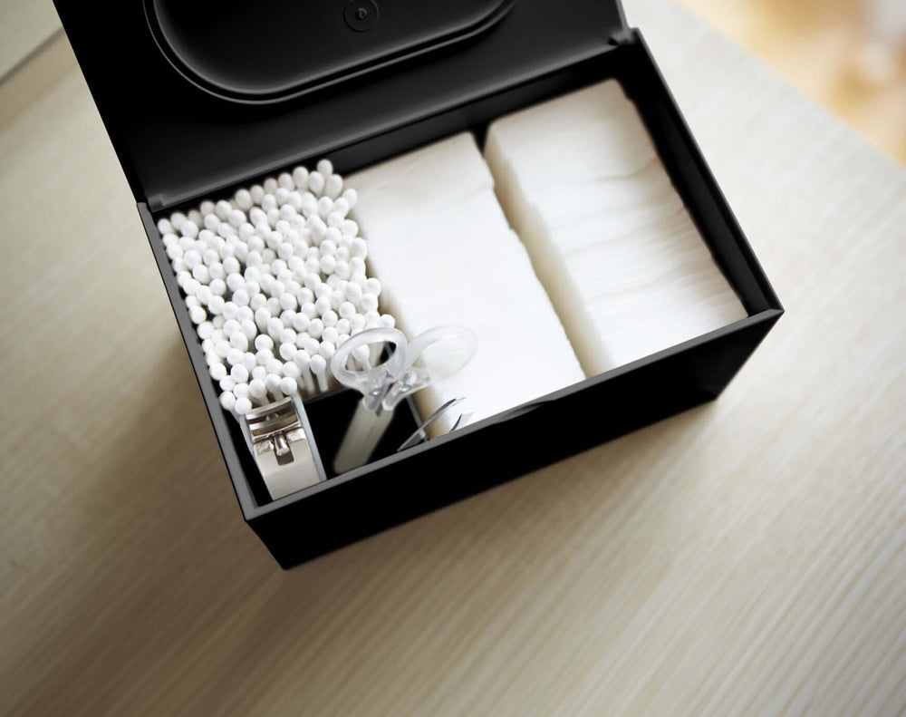 Yamazaki's black rectangular Cotton Case with lid open showing organized cotton swabs and grooming accessories