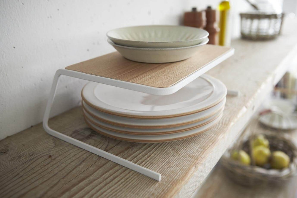 Yamazaki's wooden dish riser with white accents stacked with dishes above and below.