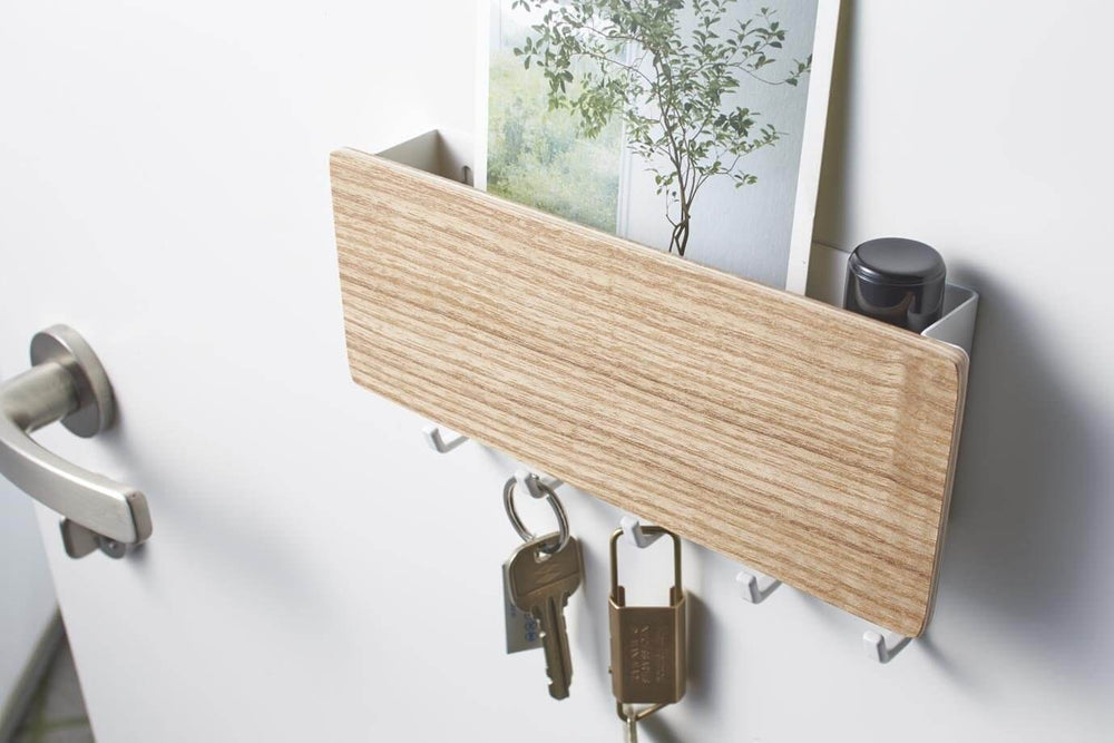 Yamazaki's magnetic key rack with wood front panel holding keys and postcards.