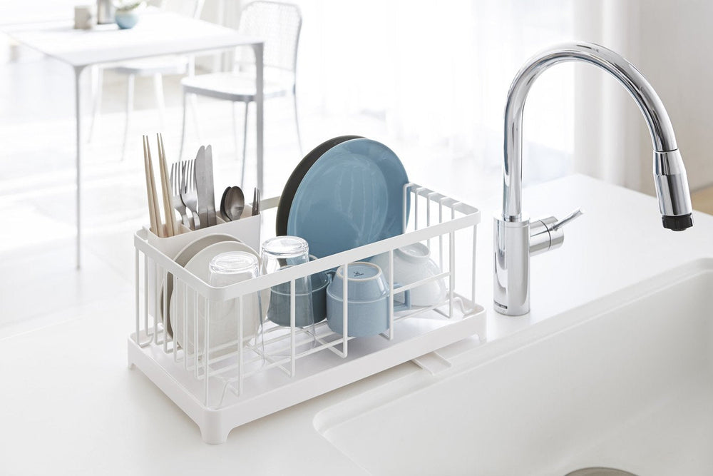 White dish rack with draining tray and space for utensils