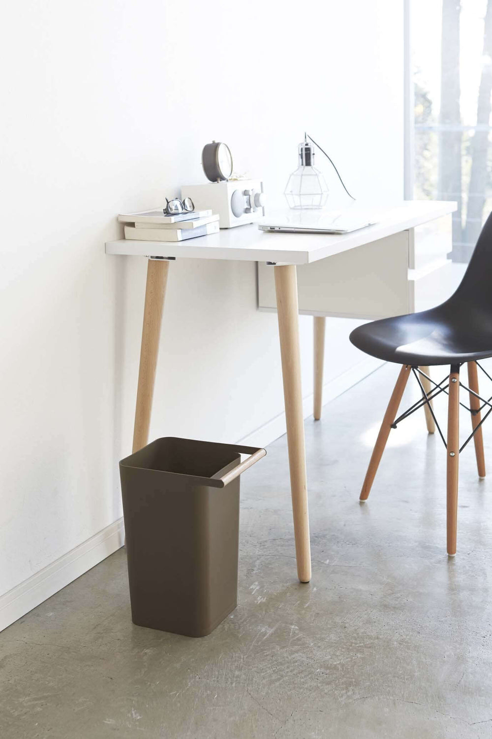 Yamazaki's wastebasket with wooden handle in office next to desk