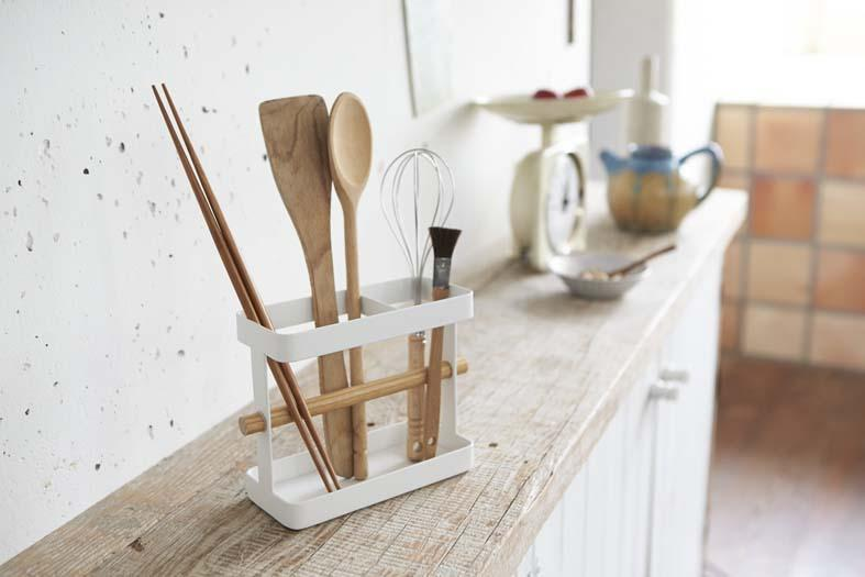 Oversize utensils in Yamazaki organizer on kitchen shelf