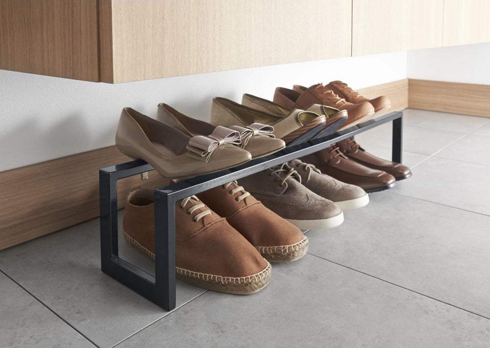 Yamazaki's Simple black shoe rack with shoes on top and bottom