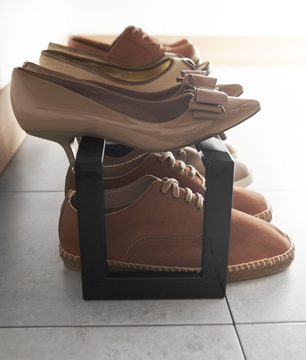 Yamazaki's Simple black shoe rack filled with shoes, seen from the side and up close.