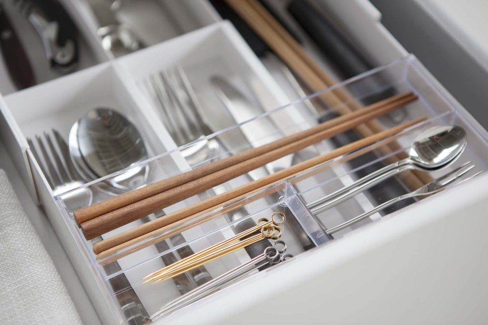 Yamazaki's white organizer filled with cutlery inside a kitchen drawer.
