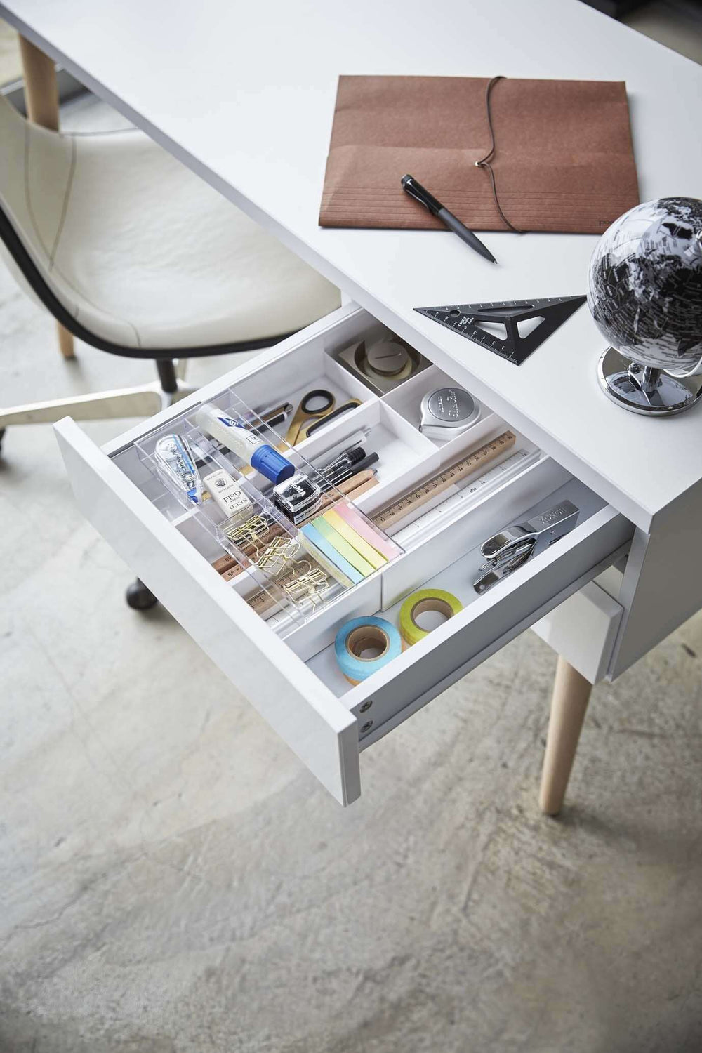Yamazaki's white organizer filled with office supplies inside a desk drawer.