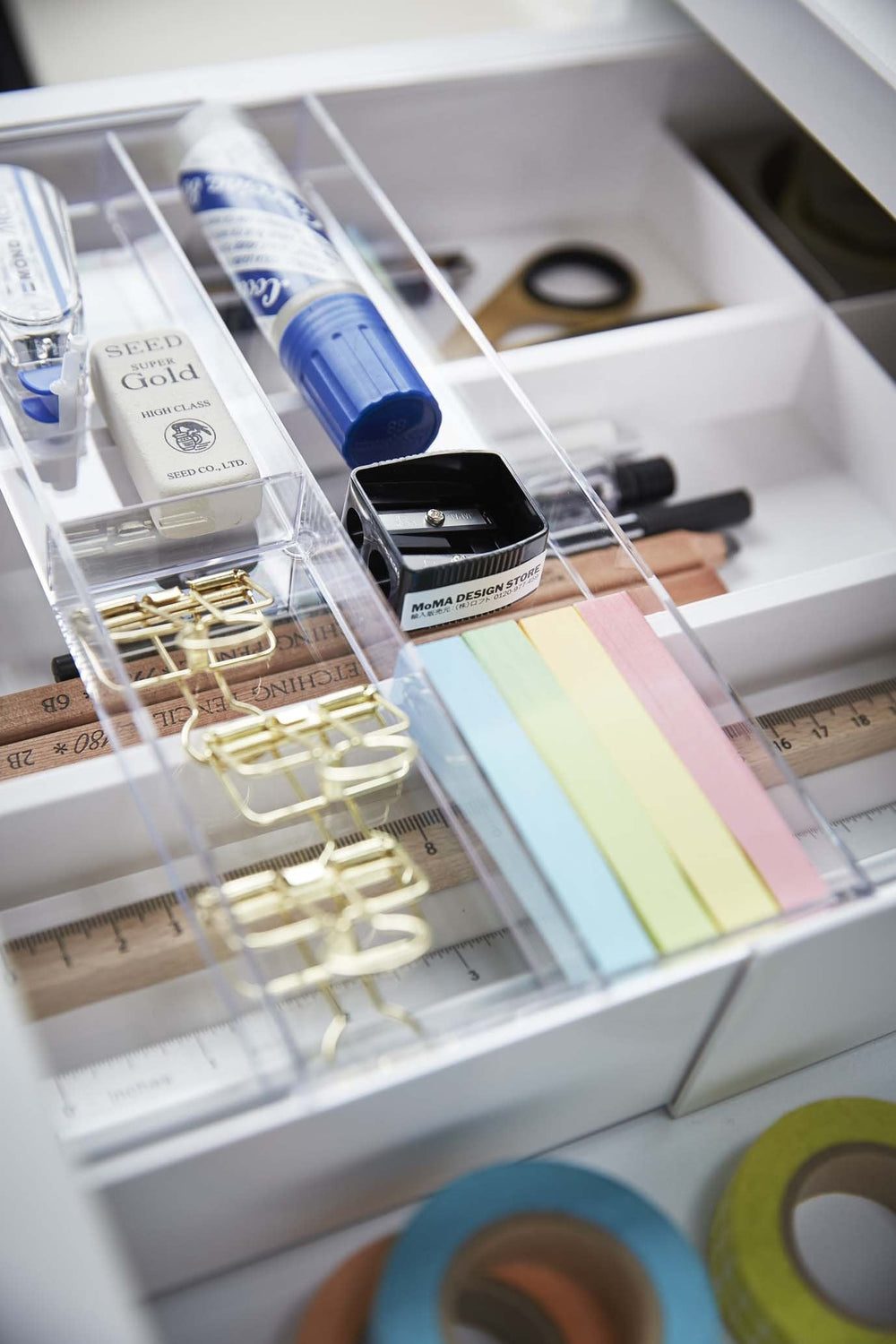Yamazaki's white organizer filled with office supplies inside a desk drawer