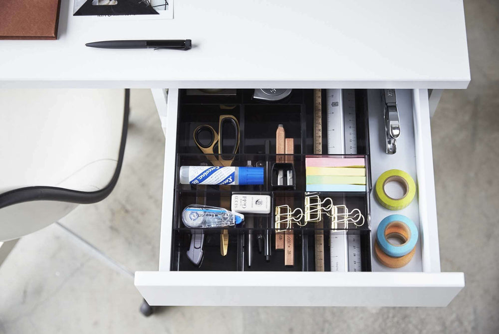 Yamazaki's desk organizer filled with office supplies inside a desk drawer