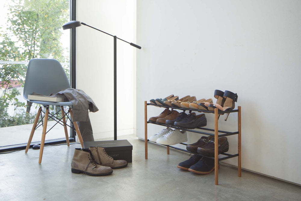 Yamazaki's three-level shoe rack filled with shoes.