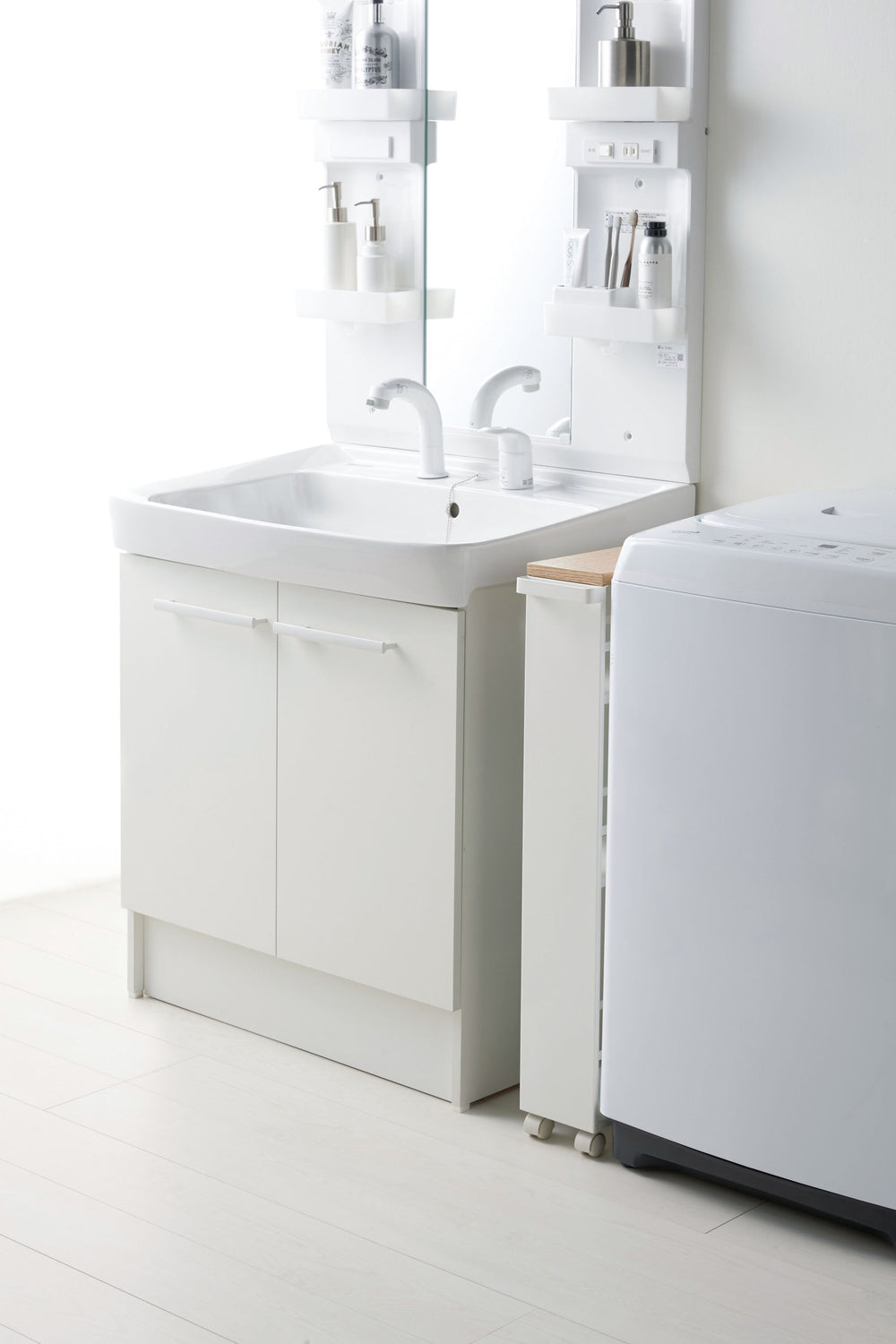 Yamazaki Rolling Storage Cart tucked into a slim space between the bathroom vanity and an appliance