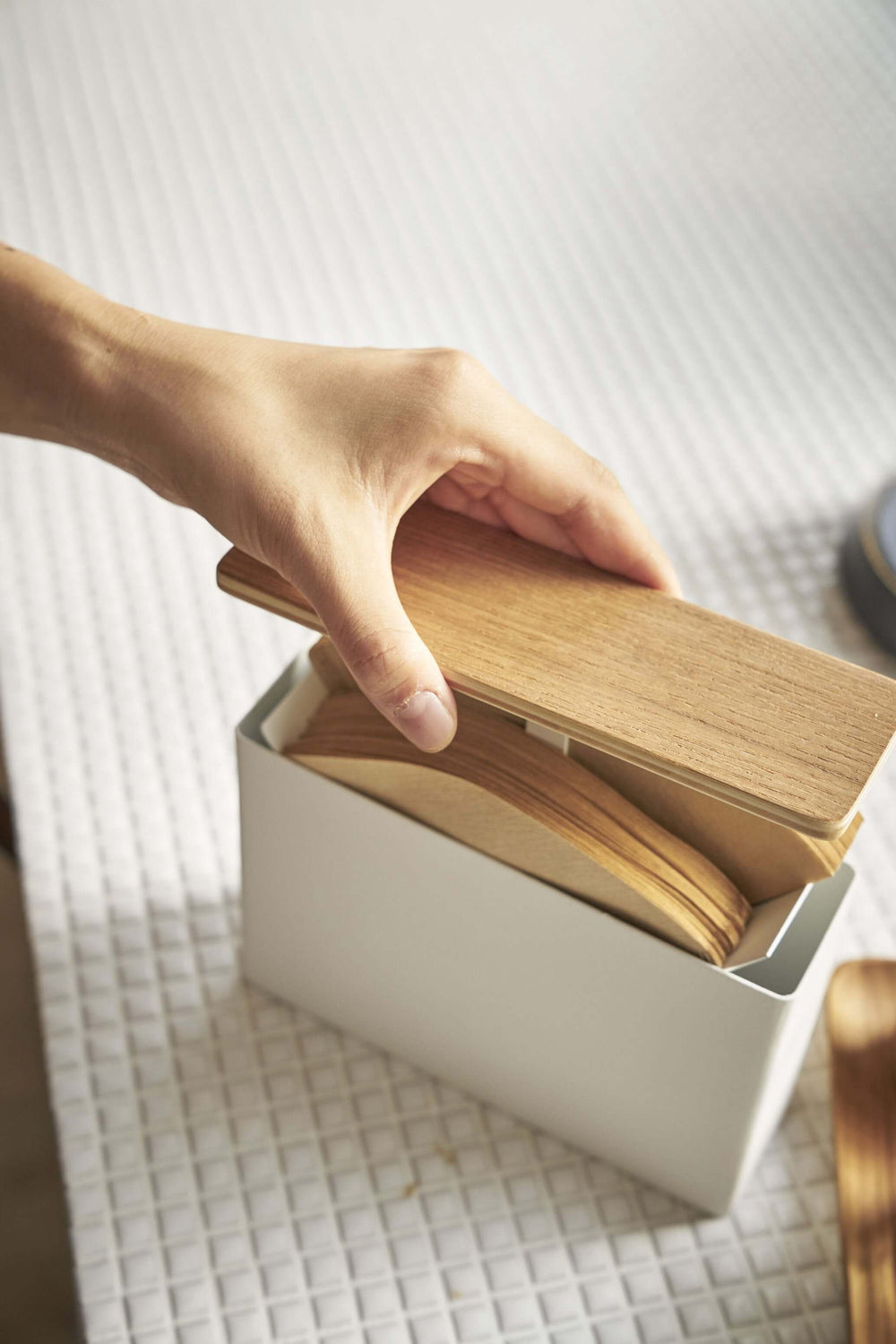 Person replacing the filters and lid to the Yamazaki Wood-Accent Coffee Filter Case