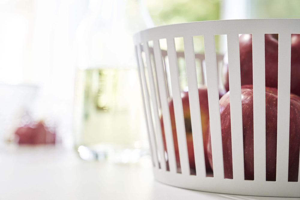 Detailed side view of apples in the white Yamazaki Striped Steel Fruit Basket