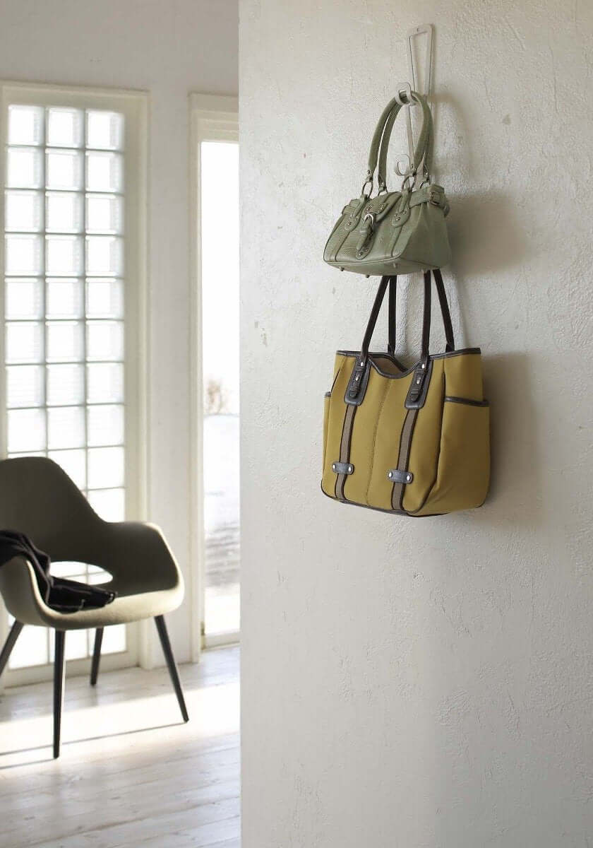 Bags attached to the wall with Yamazaki's Chain Link Bag Hanger.