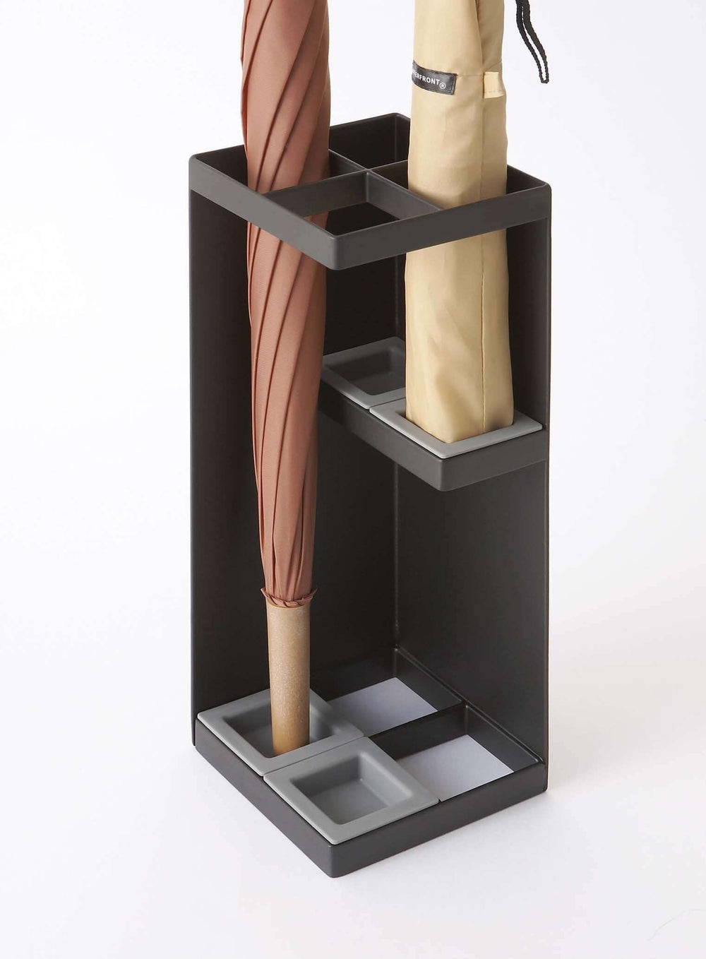 Yamazaki's umbrella stand with adjustable height interior shelves holding two umbrellas