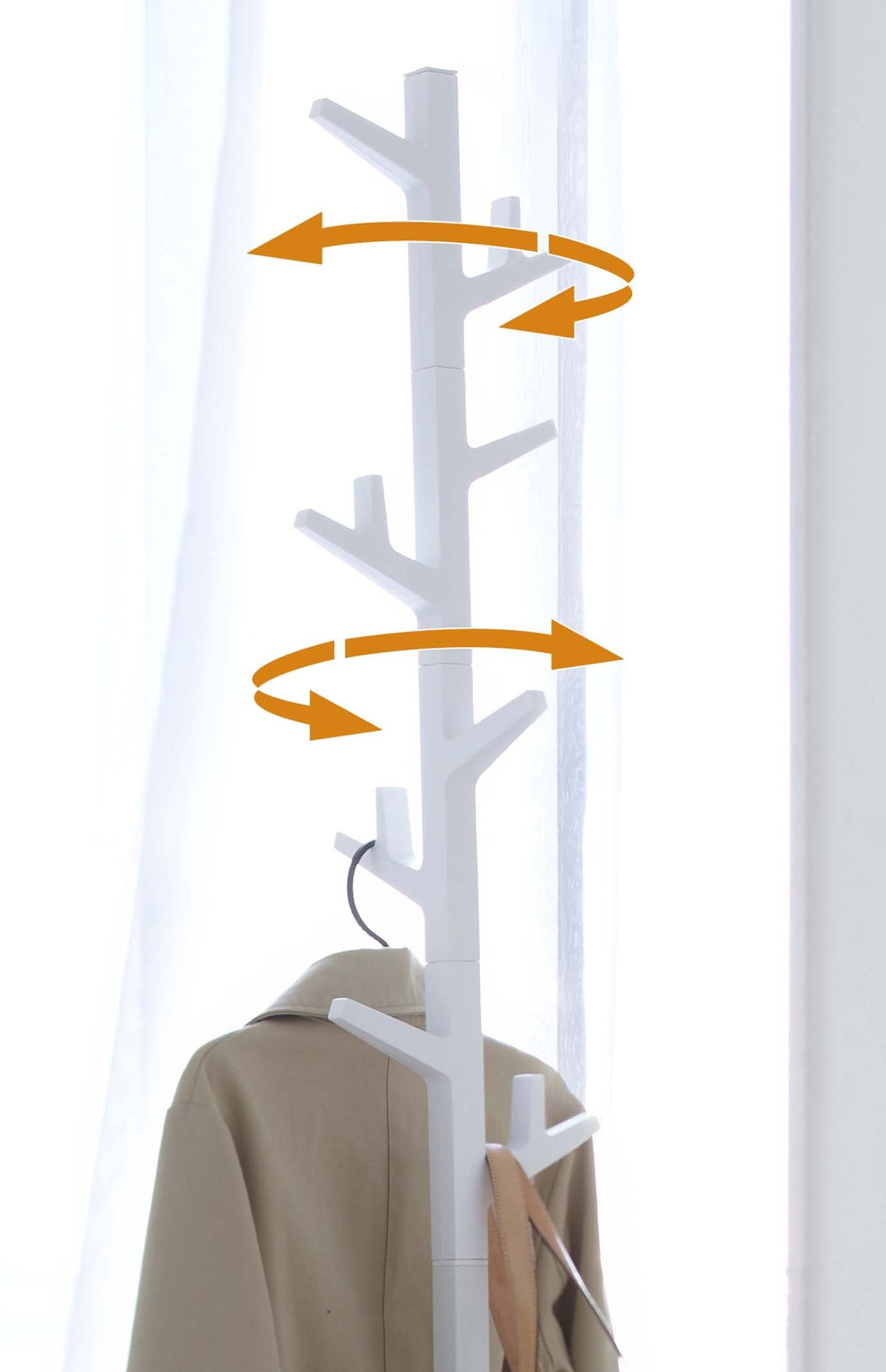 White coat rack in the shape of a tree, marked with arrows to show the movement of the rack