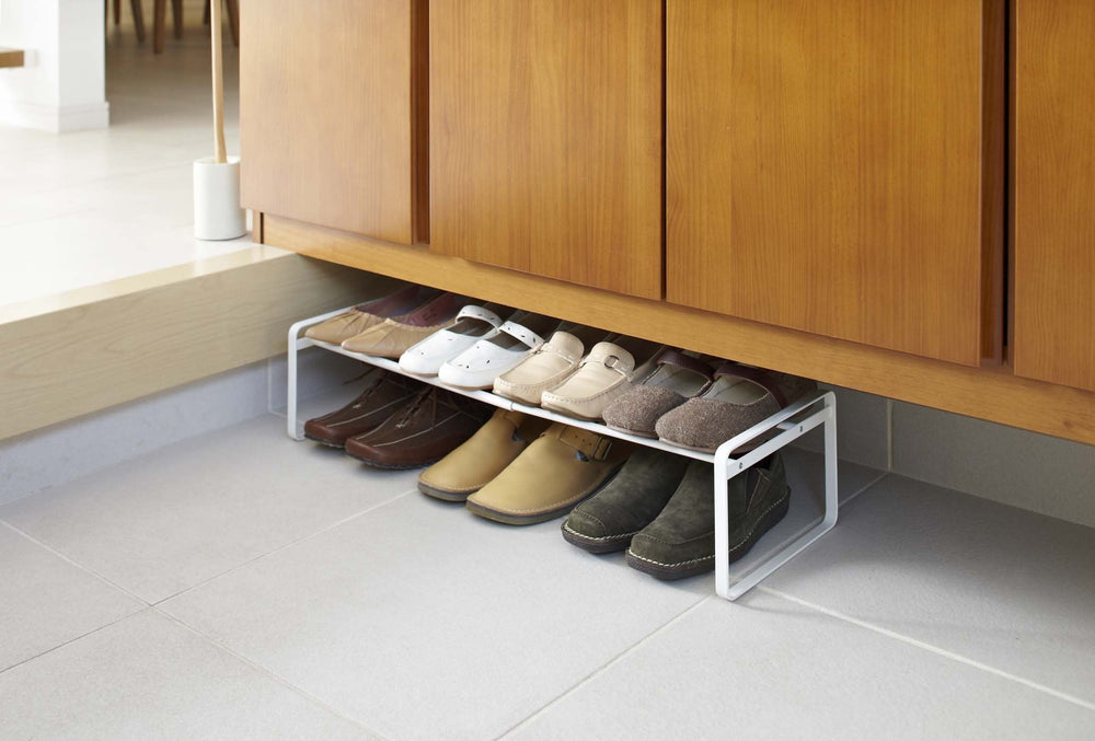 Simple white shoe rack with double bars