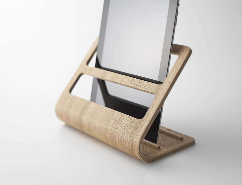 Yamazaki's light plywood stand holding a mobile tablet