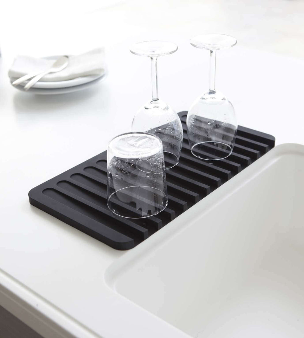 Wineglasses drying on top of Yamazaki's black silicone dish drainer tray