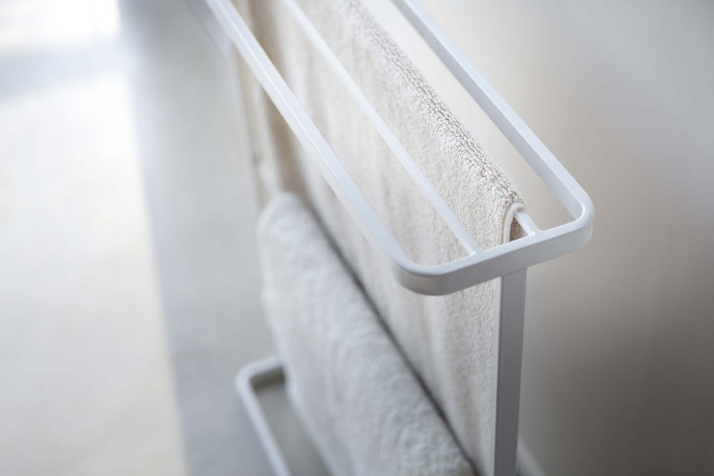 Yamazaki's Detail of white towel rack hung with two towels.
