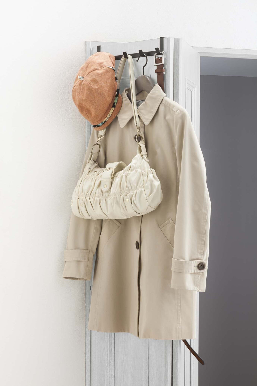 Yamazaki's wide over-door hook with five hooks hanging on a door and holding handbag and coat
