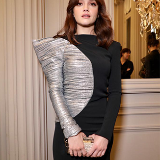 Olivia Cooke Wears Okhtein's Swarovski Felucca Clutch During PFW