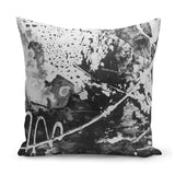 grey cushion with energetic splashy paint design