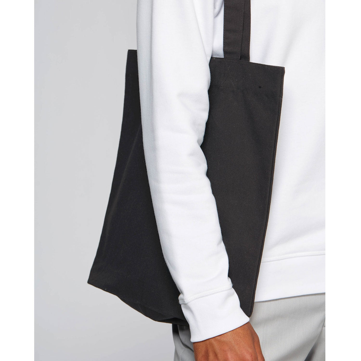 black tote bag on model's shoulder