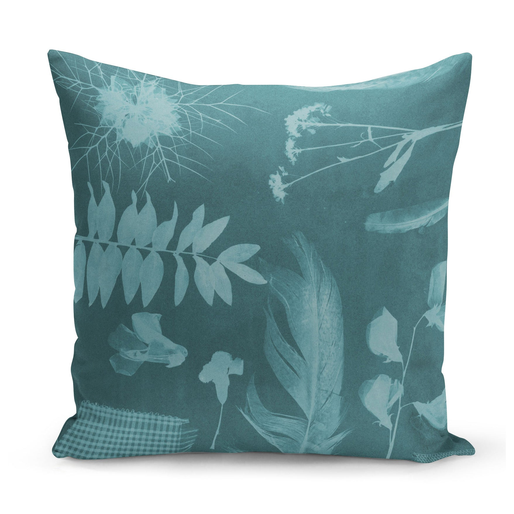 teal green cushion with x-ray style images of feathers, flowers and plants