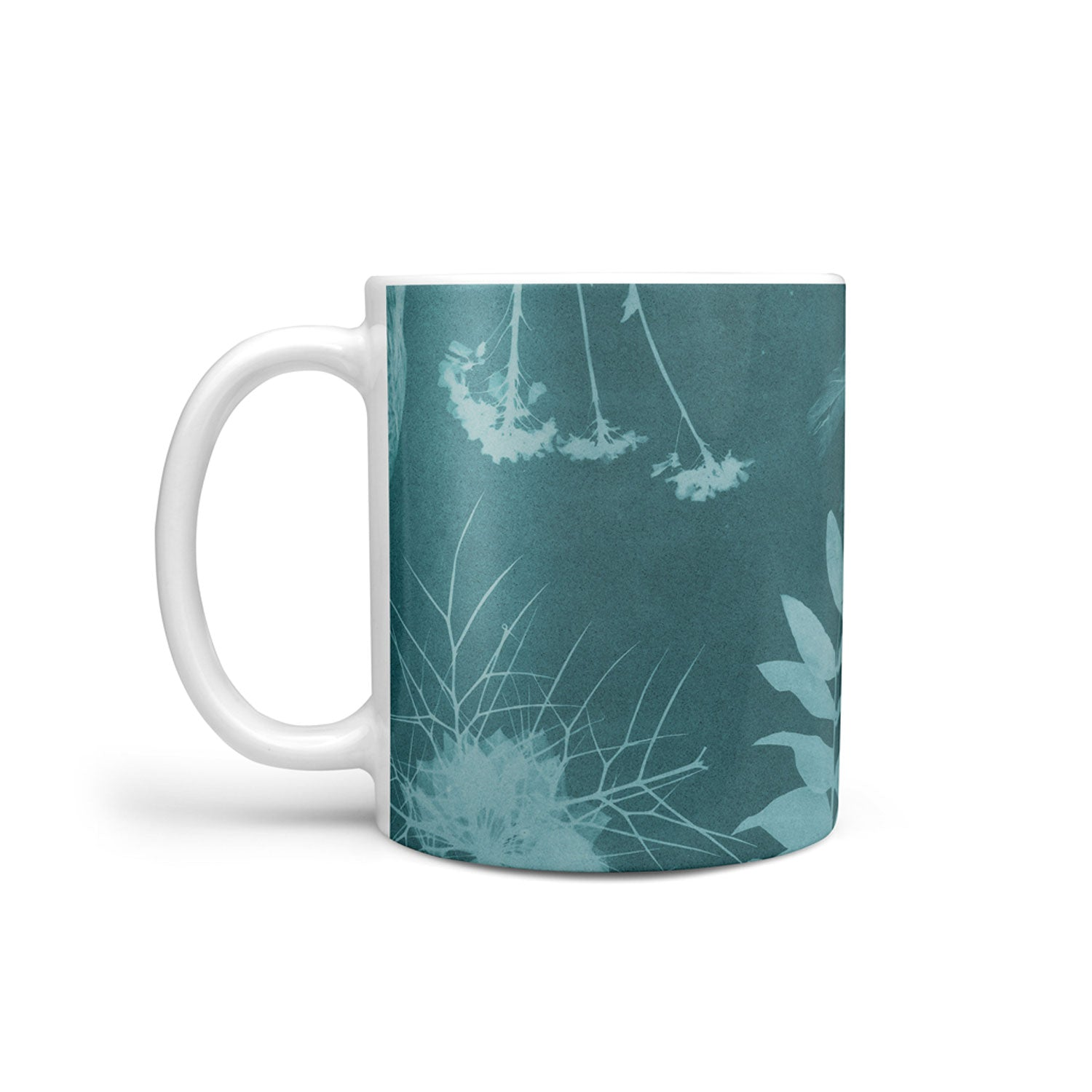 teal mug with botanical design