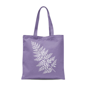 lavender-coloured tote bag with white leaf design
