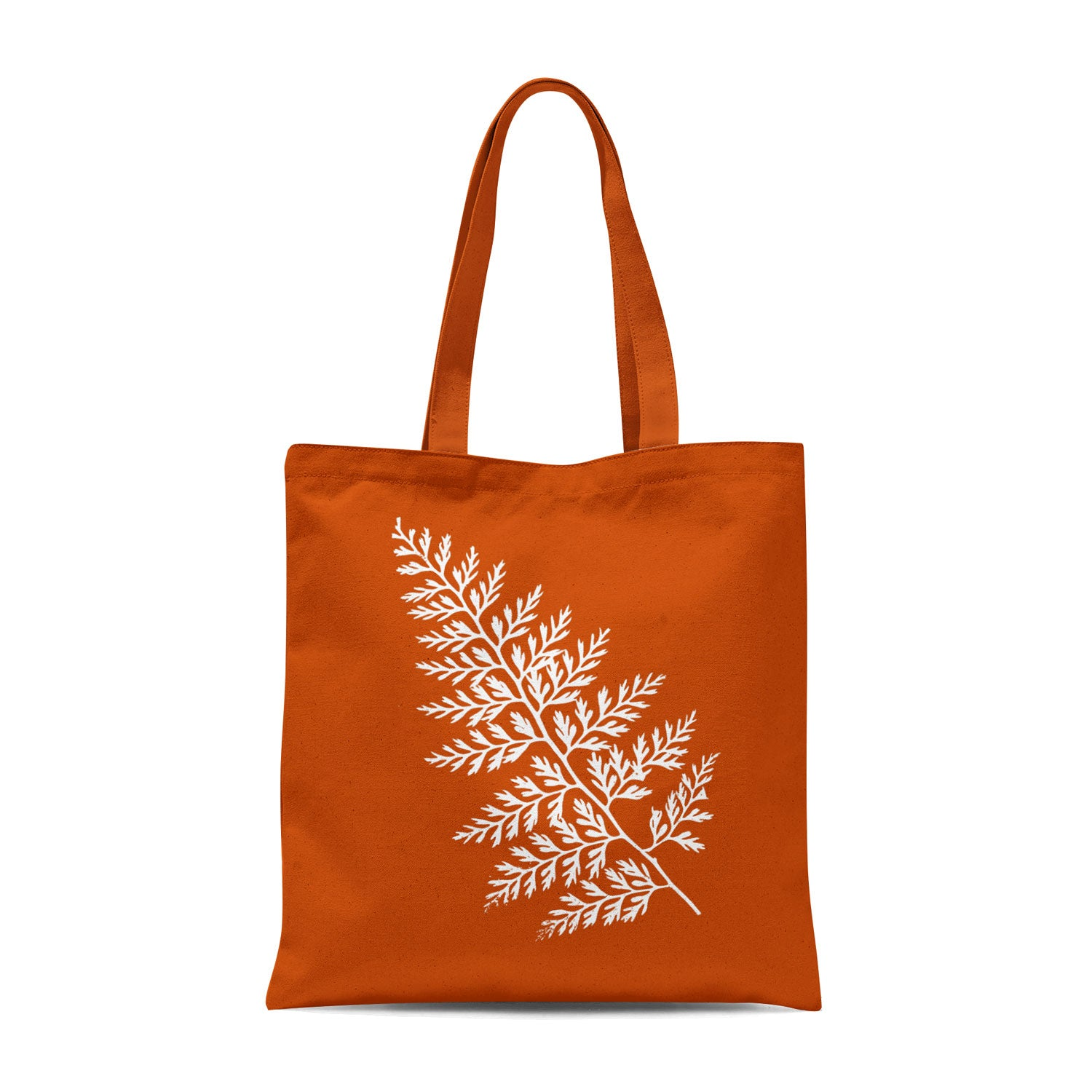 orange tote bag with white leaf design