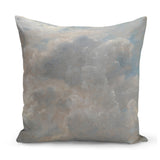 cushion with painted cloud design in grey and cream