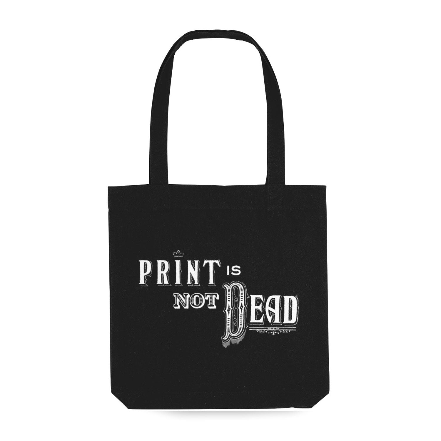 black tote bag with vintage lettering in white reading 'print is not dead'