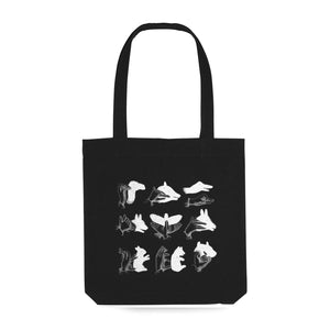 black tote bag with vintage illustration of shadow animals in white
