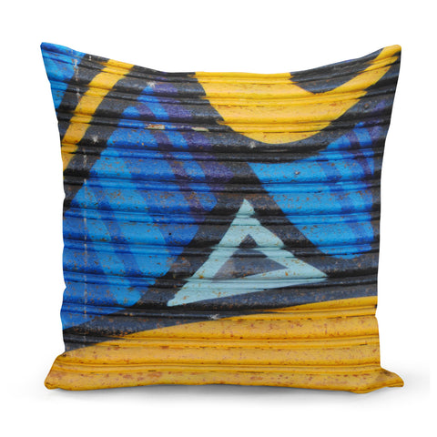 blue and yellow graffiti print cushion