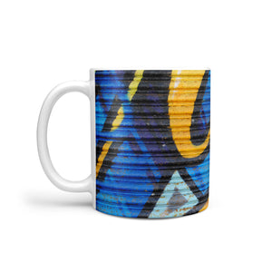 funky mug with blue and yellow spraypaint graffiti design