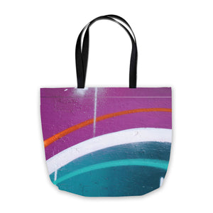 shopping bag with spraypaint design in purple and teal