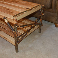 Side view of A&L Furniture Rustic Hickory Coffee Table with Shelf