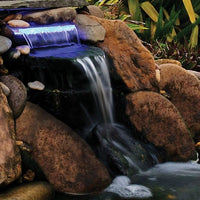 Pond Boss® Lighted Waterfall LED Spillway in a waterfall