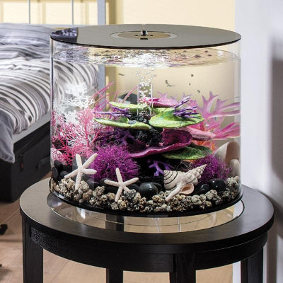 biOrb® TUBE 35 Aquarium Kit on small table in bedroom