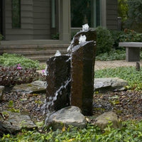 AquascapePRO® Mongolian Basalt Landscape Fountain installed in home garden