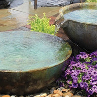 Beautiful cascading patio fountain using Aquascape® Spillway Bowl and Basin Landscape Fountain Kit