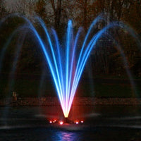 Kasco® Premium Palm Nozzle for J Series Fountains lit up at night