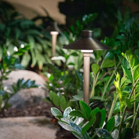 Aquascape® Path and Area LED Hat Top Landscape Lights planted in patio garden