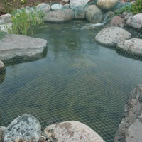 Aquascape® Protective Pond Netting stretched across pond to keep leaves and debris out