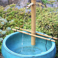 "Bamboo Accents 18"" Adjustable Spout & Pump Kit installed in container water feature"